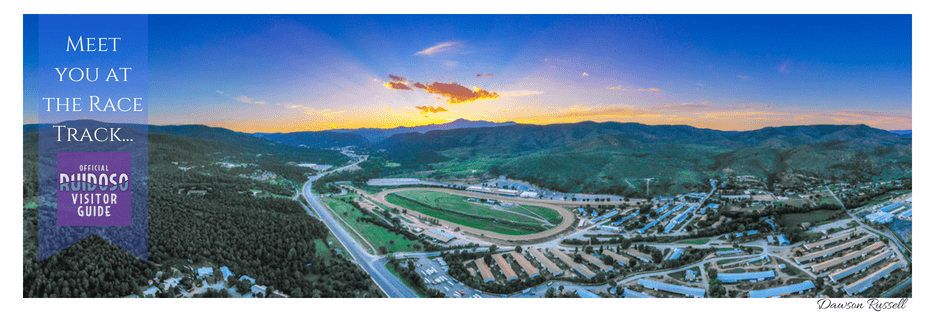 Colorful sky horizon of mountains, Ruidoso Downs Racetrack foreground. Panoramic view.