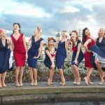 happy photo of cast of satin dollz outdoors